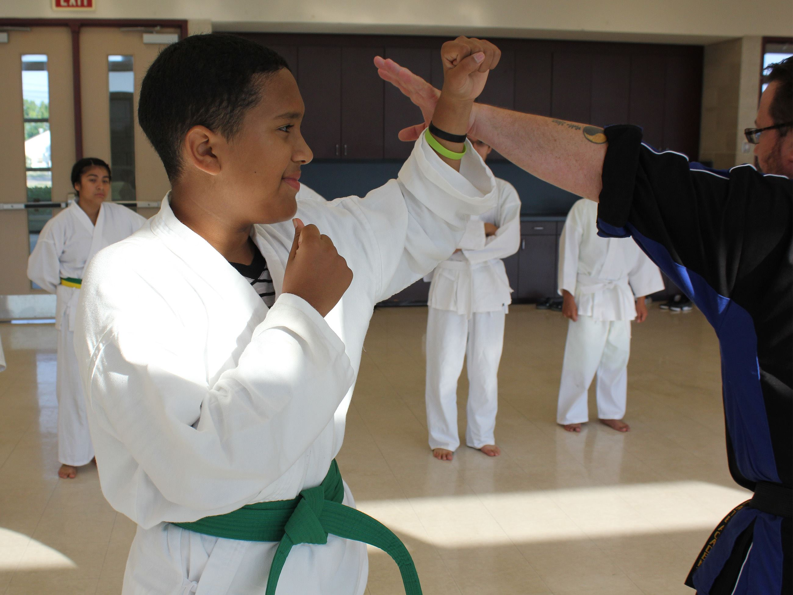 Instructor and student practicing Tae Kwon Do