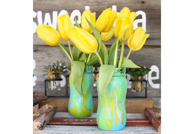 A pastel dripped vase with daffodils