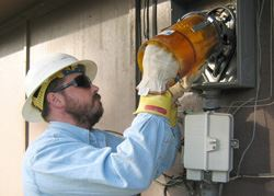 Worker Reading a Utility Meter